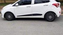 Cần bán gấp Hyundai Grand i10 đời 2014, màu trắng, nhập khẩu nguyên chiếc