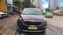 Bán xe Kia Sedona 3.3 AT đời 2015, màu nâu, giá cạnh tranh