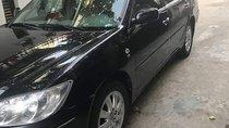 Cần bán xe Toyota Camry đời 2002, màu đen