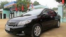 Bán xe Toyota Corolla Altis 1.8G MT đời 2008, màu đen đã đi 180000 km, giá 420tr