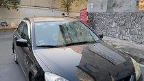 Cần bán Mitsubishi Lancer đời 2004, màu đen chính chủ giá cạnh tranh