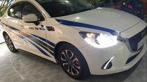 Chính chủ bán Mazda 2 đời 2016, màu trắng, xe nhập