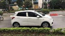 Chính chủ bán xe Hyundai Grand i10 sản xuất 2014, màu trắng, nhập khẩu