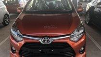 Bán xe Toyota Wigo 1.2 số sàn 2019, màu cam, nhập khẩu