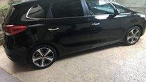 Gia đình bán Kia Rondo 2.0 GATH đời 2014, màu đen, full options