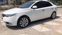 Cần bán lại xe Kia Cerato 1.6 MT đời 2009, màu trắng, nhập khẩu