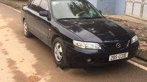 Bán Mazda 626 đời 2003, màu đen, 138 triệu