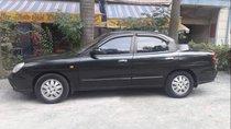 Cần bán xe Daewoo Nubira CDX 2.0 năm 2003, màu đen, xe nhập xe gia đình