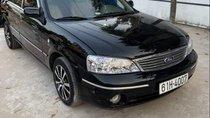 Cần bán gấp Ford Laser 2004, màu đen