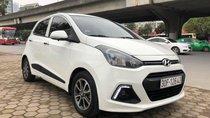 Cần bán Hyundai Grand i10 1.2AT nhập khẩu, số tự động, màu trắng