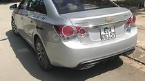 Cần bán gấp Chevrolet Cruze LS 1.6 MT 2010, màu bạc xe gia đình