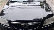 Cần bán Mazda 323 đời 2002, màu đen, xe đẹp nguyên bản