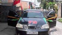Cần bán lại xe Daewoo Lacetti năm 2004, màu đen