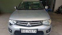 Cần bán xe Mitsubishi Triton 2009 máy dầu, 4x2 MT, màu bạc, odo 96.000Km, biển số TP