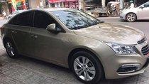 Cần bán xe Chevrolet Cruze 16 LTZ tự động, màu vàng cát
