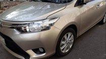 Bán lại xe Toyota Vios đời 2017, màu vàng cát