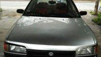 Cần bán gấp Mazda 323 1997, màu bạc, xe đẹp, máy ngon