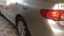 Cần bán gấp Toyota Corolla altis đời 2009, màu bạc như mới