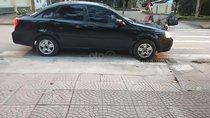 Gia đình bán ô tô Daewoo Lacetti EX 1.6 MT đời 2004, màu đen, 135tr