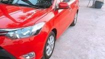 Bán chiếc Vios E màu đỏ, số sàn, Sx năm 2015, xe còn rất mới và ít sử dụng