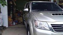 Cần bán lại xe Toyota Hilux 3.0G 4x4 MT đời 2014, màu vàng, nhập khẩu