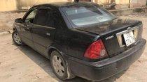 Cần bán gấp Ford Laser năm 2002, màu đen, giá tốt