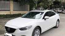 Cần bán Mazda 6 2.0AT 2016 màu trắng, odo 82.000 Km