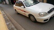 Gia đình cần bán Daewoo Lanos SX đời 2004, màu trắng, giá 72tr