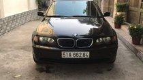 Cần bán BMW 318i sản xuất 2004, màu đen, số tự động