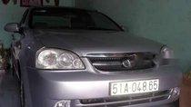 Cần bán xe Daewoo Lacetti năm 2011, màu bạc
