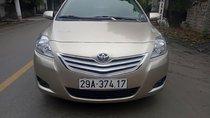 Cần bán lại xe Toyota Vios 1.5E sản xuất 2010, màu ghi vàng