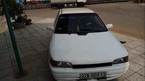 Cần bán gấp Mazda 323 đời 1995, màu trắng, đèn trước sau mới thay, về chỉ việc đi