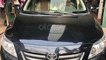 Bán xe Toyota Corolla Altis 1.8G sx 2009, số tay, máy xăng, màu đen, nội thất màu kem, đã đi 154000 km