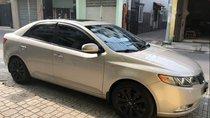 Cần bán Kia Forte 2013 tự động, màu vàng cát, Thaco ráp