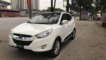Bán gấp Hyundai Tucson màu trắng sản xuất 2011, chạy 8 vạn km, nhập Hàn Quốc