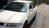 Bán xe Mazda 323 màu trắng, đời 2001, máy móc ổn