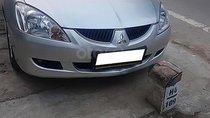 Cần bán xe Mitsubishi Lancer đời 2004, màu bạc, xe đi ít giữ gìn cẩn thận