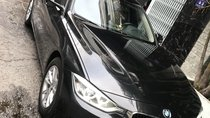Bán BMW 320i đời 2014, màu đen, nhập khẩu nguyên chiếc