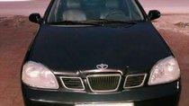 Cần bán Daewoo Lacetti đời 2004, màu đen, xe gia đình