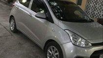 Cần bán lại xe Hyundai Grand i10 đời 2014, màu bạc, nhập khẩu xe gia đình