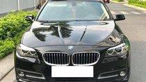 BMW 520i màu nâu/kem sản xuất 2016, đăng ký biển Hà Nội