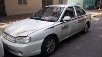 Cần bán gấp Kia Spectra năm sản xuất 2004, màu trắng, giá 105tr