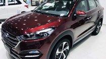 Cần bán gấp Hyundai Tucson sản xuất 2014, màu đỏ giá cạnh tranh