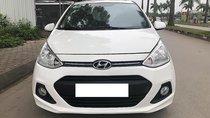 Bán xe Hyundai Grand i10 năm sản xuất 2014, màu trắng, nhập khẩu, số sàn