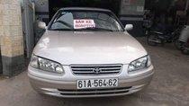 Bán Toyota Camry GLi năm 2001, màu vàng cát, 2 ghế điện
