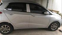 Cần bán gấp Hyundai Grand i10 đời 2014, màu bạc, xe đẹp
