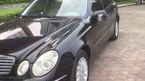 Cần bán Mercedes E240 sản xuất 2003, màu đen, nhập khẩu chính chủ
