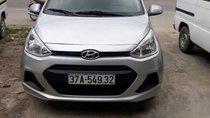 Cần bán gấp Hyundai Grand i10 đời 2015, màu bạc, nhập khẩu xe gia đình