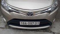 Cần bán xe Toyota Vios 1.5E CVT đời 2017, màu vàng, số tự động, giá tốt