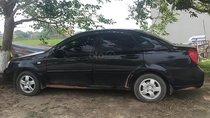 Cần bán lại xe Daewoo Lacetti EX sản xuất 2010, màu đen số sàn